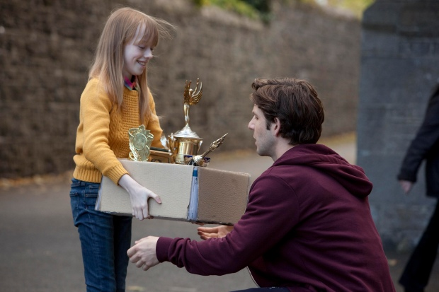 Jenny Rane gives Danny Dempsey a box of trophies. © RTÉ